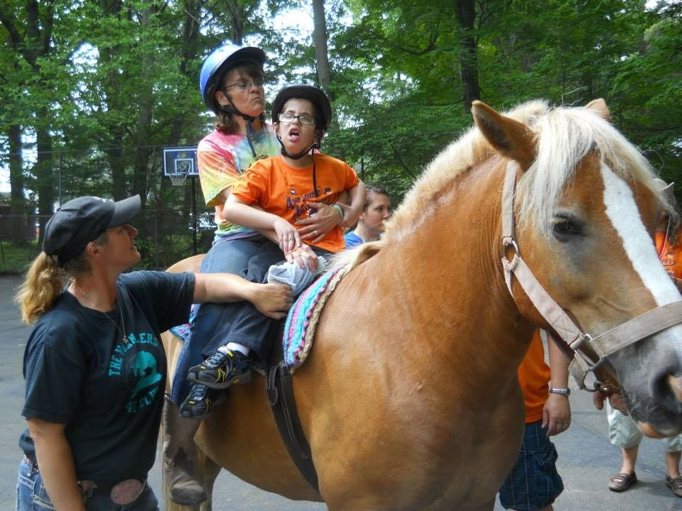 Steve riding a horse at camp